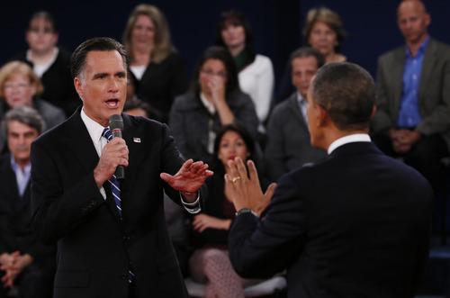 Republican presidential nominee Mitt Romney, left, addresses President Barack Obama  during the second presidential debate at Hofstra University, Tuesday, Oct. 16, 2012, in Hempstead, N.Y. (AP Photo/Pool-Shannon Stapleton)