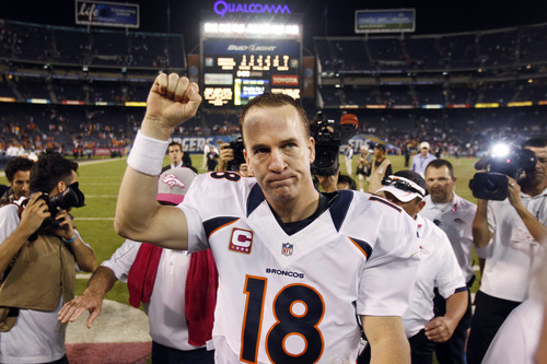 Denver Broncos quarterback Peyton Manning pumps his fist as he leaves the field following their 35-24 win over the San Diego Chargers in an NFL football game, Monday, Oct. 15, 2012, in San Diego. (AP Photo/Lenny Ignelzi)