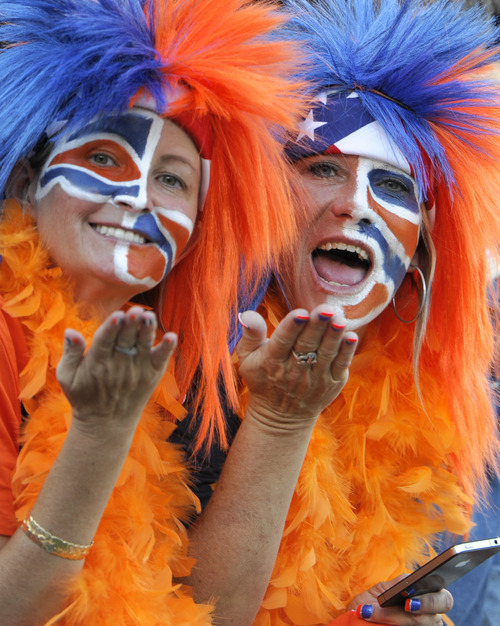 Denver Broncos fans look on before an NFL football game between the Denver Broncos and the San Diego Chargers Monday, Oct. 15, 2012, in San Diego. (AP Photo/Denis Poroy)