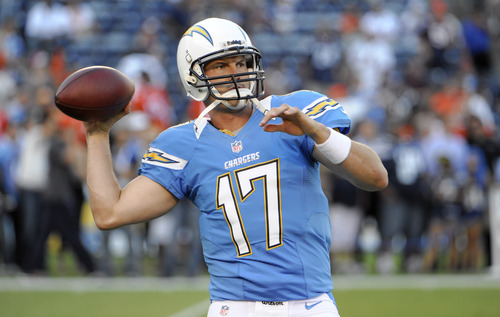 San Diego Chargers quarterback Philip Rivers warms up before an NFL football game between the Denver Broncos and the San Diego Chargers Monday, Oct. 15, 2012, in San Diego. (AP Photo/Denis Poroy)