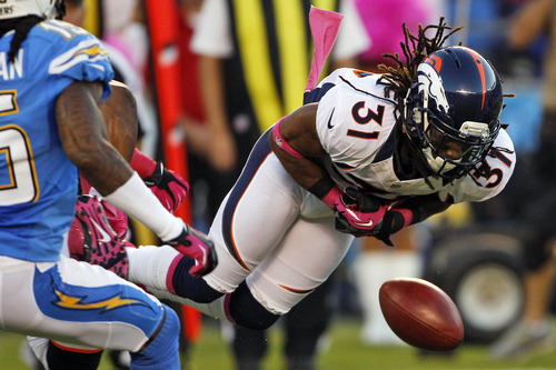 Denver Broncos cornerback Omar Bolden loses control of the ball on a kickoff as San Diego Chargers'  Richard Goodman, left, watches during the first half of an NFL football game, Monday, Oct. 15, 2012, in San Diego. The Chargers gained control of the ball on the play. (AP Photo/Lenny Ignelzi )