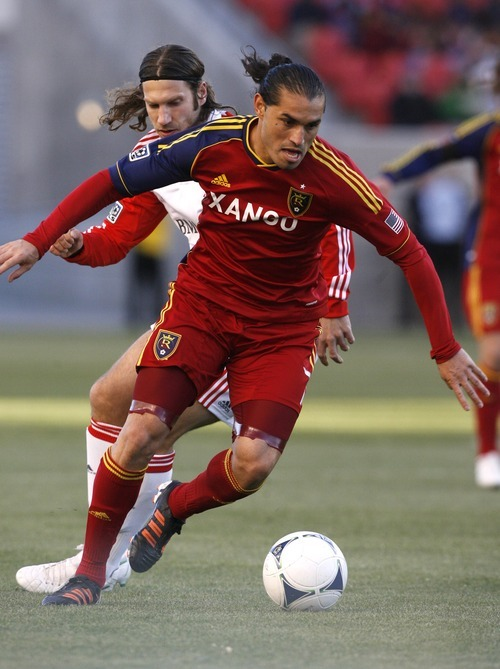 Rick Egan  | The Salt Lake Tribune   Real Salt Lake's Fabian Espindola (7)  carries the ball up the field, in RSL action, Real Salt Lake vs. Toronto FC,  in Salt Lake City, Saturday, April 28, 2012.