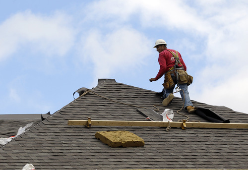 In this Friday, Oct. 12, 2012, photo, a construction worker finishes a roof in Chicago. Confidence among U.S. homebuilders is at its highest level in six years in October, reflecting improved optimism over the strengthening housing market this year and a pickup in visits by prospective buyers to builders' communities. (AP Photo/Nam Y. Huh)