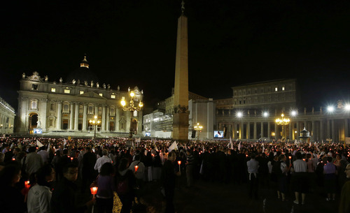 Faithful crowd the square during a candlelight procession to mark the 50th anniversary of the Second Vatican Council, the church meetings that modernized the Catholic Church but whose true results are still hotly debated, in St. Peter's square, at the Vatican, Thursday, Oct. 11, 2012. Pope Benedict XVI denounced the