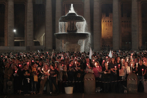 Faithful gather for a candlelight procession to mark the 50th anniversary of the Second Vatican Council, the church meetings that modernized the Catholic Church but whose true results are still hotly debated, in St. Peter's square, at the Vatican, Thursday, Oct. 11, 2012. Pope Benedict XVI denounced the