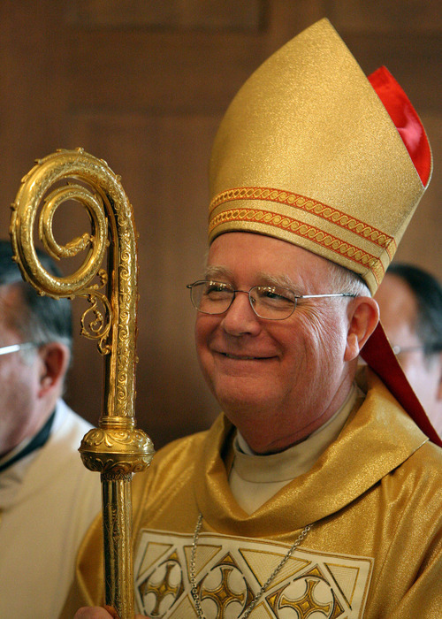 Steve Griffin     Tribune file photo Bishop George Niederauer smiles as he waits to enter the sanctuary prior to his farewell Mass at The Cathedral of the Madeleine on Feb. 5, 2006.
