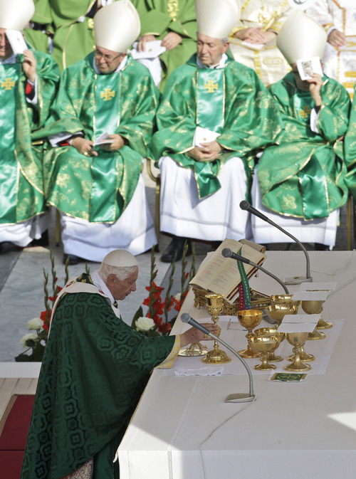 Pope Benedict XVI, foreground,  celebrates a Mass marking the 50th anniversary of the Second Vatican Council, in St. Peter's Square, at the Vatican, Thursday, Oct. 11, 2012. Benedict, after celebrating Mass, will greet churchmen, including a dozen original Vatican II participants, re-enacting the great procession into St. Peter's that launched the council in 1962. (AP Photo/Andrew Medichini)