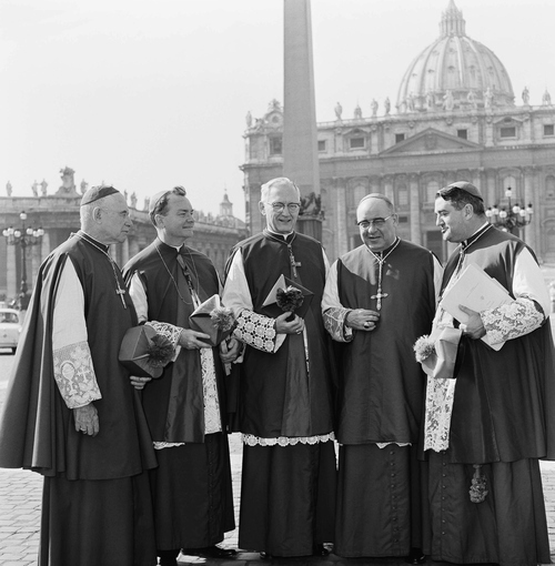 American bishops named to help U.S. newsmen covering the Roman Catholic Ecumenical Council in Rome stand before St. Peter's Basilica, Oct. 23, 1962.  From the left to right: Bishop Thomas H. Gorman of Dallas, Tex.;  auxiliary Bishop Philip M. Hannan of Washington, D.C.;  Bishop Albert R. Zuroweste of Belleville, Ill., chairman;  auxiliary Bishop James H. Griffith of New York City; and Bishop John J. Wright, Pittsburgh, Pa. (AP Photo)