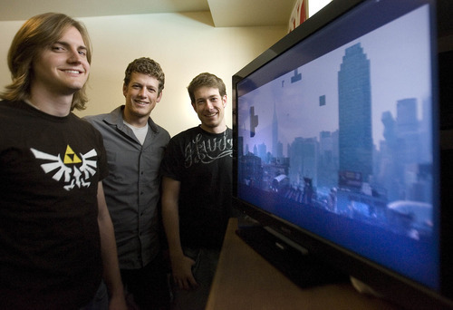Paul Fraughton  |  The Salt Lake Tribune Mike Brown, Casen and Landon Sperry stand next to a screen playing one of their video productions.
