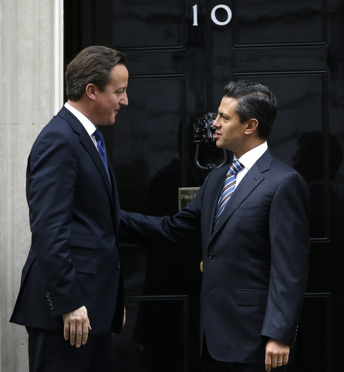 Britain's Prime Minister David Cameron, left, greets the Mexican President elect Enrique Pena Nieto at 10 Downing Street in London, Tuesday, Oct. 16, 2012. (AP Photo/Alastair Grant)