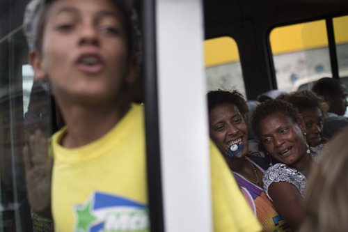 Suspected crack users sit inside a van as they wait to be taken to a shelter after being removed from the streets by social workers near the Parque Uniao slum in Rio de Janeiro, Brazil, Wednesday, Oct. 17, 2012. A crew of social workers, psychologists and others rounded up drug users found in the streets Wednesday, and took them to shelters. The adults don't have to stay, and the majority leave as soon as they've had a meal and a shower. (AP Photo/Felipe Dana)