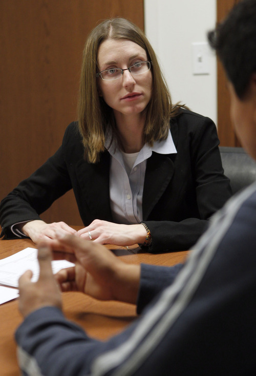 Al Hartmann  |  The Salt Lake Tribune Shauna LaBeau, a certified financial counselor at AAA Fair Credit in Salt Lake City goes over a credit report with a client during a counseling session Tuesday October 16.   Utah bankruptcy filings are down 13 percent for the first nine months of 2012.