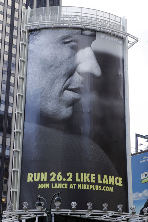 FILE - In an 80-foot billboard at 34th Street and 7th Avenue in Manhattan, Lance Armstrong and Nike challenge New Yorkers to