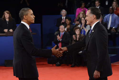 President Barack Obama, left, shakes hands with Republican presidential nominee Mitt Romney at the end of the second presidential debate at Hofstra University, Tuesday, Oct. 16, 2012, in Hempstead, N.Y. (AP Photo/Pool-Michael Reynolds)