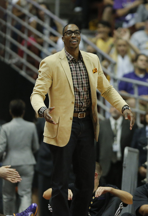 Los Angeles Lakers' Dwight Howard reacts to a basket made by Reeves Nelson in the second half of an NBA preseason basketball game against the Utah Jazz in Anaheim, Calif., Tuesday, Oct. 16, 2012. The Jazz won 114-80. (AP Photo/Jae Hong)