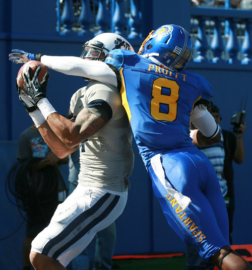 Utah State wide receiver Matt Austin, left, catches a pass for a touchdown over San Jose State's  cornerback Jimmy Pruitt (8) in the first quarter of an NCAA college football game in San Jose, Calif., Saturday, Oct. 13, 2012. (AP Photo/Darryl Bush)