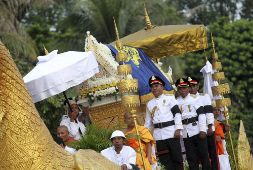 A phoenix float with the casket carrying the body of former Cambodian King Norodom Sihanouk arrives at the Royal Palace as mourners lining up the streets to pay their respects in Phnom Penh, Cambodia, Wednesday Oct. 17, 2012. The body of Cambodia's late King returned to his homeland on a plane from China on Wednesday, welcomed by tens of thousands of mourners who packed tree-lined roads in the Southeast Asian nation's capital ahead of the royal funeral. (AP Photo/Wong Maye-E)