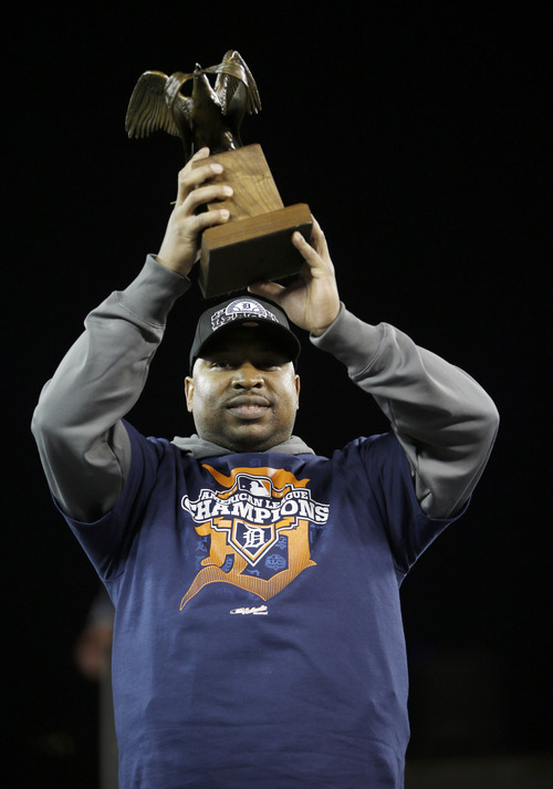 Detroit Tigers' Delmon Young holds the most valuable player trophy after his team won Game 4 of the American League championship series, 8-1, against the New York Yankees, Thursday, Oct. 18, 2012, in Detroit. The Tigers move on to the World Series.(AP Photo/Matt Slocum)