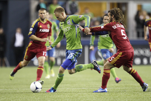 Real Salt Lake's Kyle Beckerman, right, tries to slow Seattle Sounders' Andy Rose (25) during the first half of an MLS soccer match, Wednesday, Oct. 17, 2012, in Seattle. (AP Photo/Ted S. Warren)