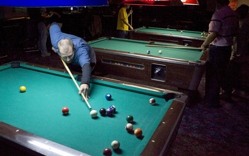 Keith Johnson | The Salt Lake Tribune Ryan Urry shoots pool at Club DJ's in Taylorsville.