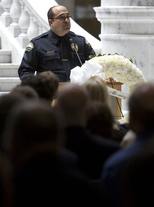 Aaron D. Rosen of the Saratoga Springs Police Department has appealed a demotion given to him after he dropped his pants in front of a female co-worker.  In this file photo, Rosen talks about officers loosing their lives in the line of duty during the State of Utah Fallen Peace Officers' Memorial Service Thursday May 8, 2008 at the Utah State Capitol rotunda. Jim Urquhart/The Salt Lake Tribune