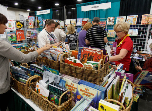 Trent Nelson  |  The Salt Lake Tribune Convention attendees look through books at the Utah Education Association (UEA) convention Thursday, October 18, 2012 in Sandy, Utah.
