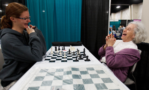 Trent Nelson  |  The Salt Lake Tribune Maureen Eldredge reacts to being put in checkmate by  granddaughter Cynthia Hammond at the Utah Education Association (UEA) convention Thursday, October 18, 2012 in Sandy, Utah.