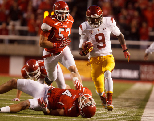 Trent Nelson  |  The Salt Lake Tribune USC's Marqise Lee streaks past Utah defensive back Brian Blechen. Lee finished with 12 catches for 192 yards and a touchdown.