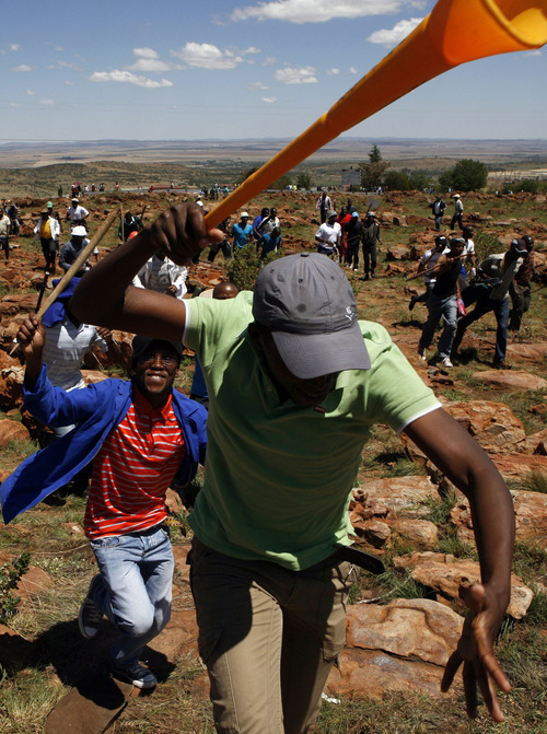 Miners sing, as they run during their strike at the AngloGold Ashanti Mine, in Fochville near Johannesburg, South Africa, Thursday, Oct. 18, 2012. Thousands of South Africa gold miners say they will continue striking despite a plea by the president that they return to work. President Jacob Zuma had urged the striking mineworkers to return to work