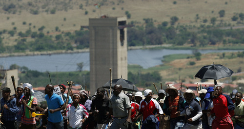 Miners sing,  during their strike at the AngloGold Ashanti Mine, in Fochville near Johannesburg, South Africa, Thursday, Oct. 18, 2012. Thousands of South Africa gold miners say they will continue striking despite a plea by the president that they return to work. President Jacob Zuma had urged the striking mineworkers to return to work