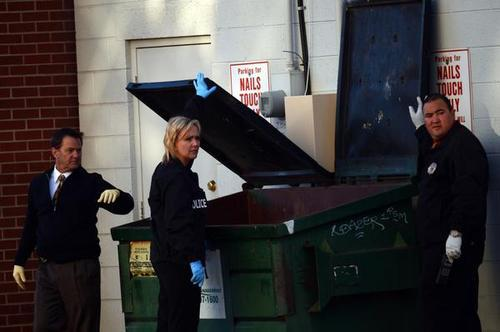 Denver police search trash dumpsters behind Fero's Bar and Grill, Wednesday, October 17, 2012, during an arson-homicide investigation where five bodies were found inside the  bar in Denver. RJ Sangosti, The Denver Post
