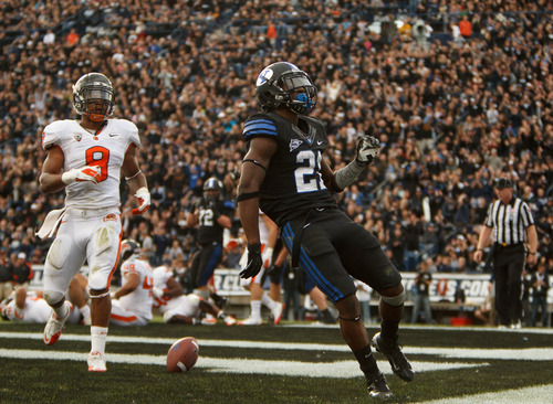 Trent Nelson  |  The Salt Lake Tribune BYU's Jamaal Williams scores a touchdown as BYU hosts Oregon State college football Saturday October 13, 2012 in Provo, Utah.