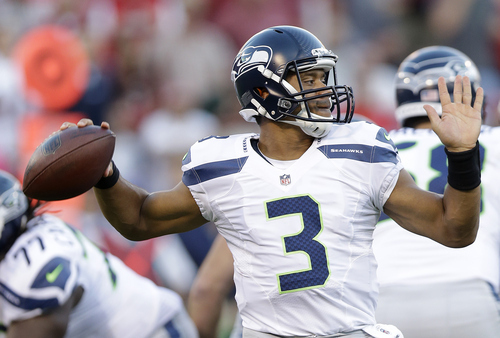 Seattle Seahawks quarterback Russell Wilson (3) passes against the San Francisco 49ers during the first quarter of an NFL football game in San Francisco, Thursday, Oct. 18, 2012. (AP Photo/Marcio Jose Sanchez)