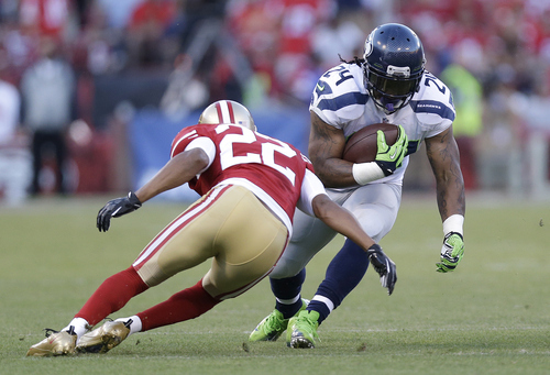 Seattle Seahawks running back Marshawn Lynch (24) runs against San Francisco 49ers cornerback Carlos Rogers (22) during the first quarter of an NFL football game in San Francisco, Thursday, Oct. 18, 2012. (AP Photo/Marcio Jose Sanchez)