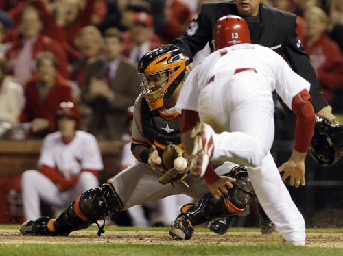 San Francisco Giants catcher Hector Sanchez can't handle the throw as St. Louis Cardinals' Matt Carpenter scores from second on a single by Matt Holliday during the fifth inning of Game 4 of baseball's National League championship series Thursday, Oct. 18, 2012, in St. Louis. (AP Photo/Jeff Roberson)