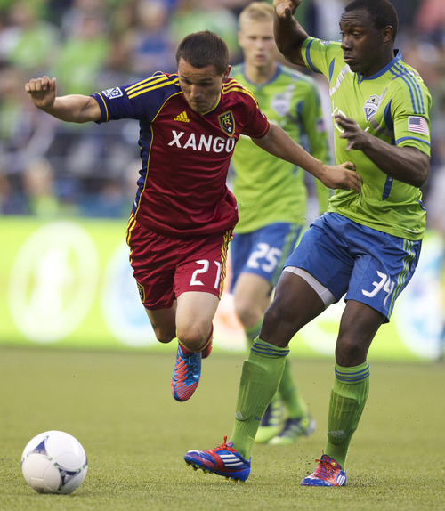 Real Salt Lake's Luis Gil is tripped by Sounders' Jhon Kennedy Hurtado during the second half of play in a MLS soccer match, Saturday, May 12, 2012, in Seattle. Real Salt Lake won the match 1-0. (AP PHOTO/Stephen Brashear)