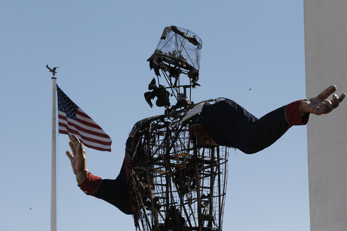 The burned remains of Big Tex stand at the State Fair of Texas Friday, Oct. 19, 2012, in Dallas. Fire destroyed Big Tex on Friday, leaving behind little more than the metal frame of the 52-foot-tall metal-and-fabric cowboy that is an icon of the State Fair of Texas. (AP Photo/LM Otero)