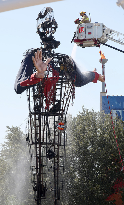 Dallas firefighters put out the last hot spots after Big Tex caught fire at the State Fair of Texas, in Fair Park on Friday, Oct. 19, 2012 in Dallas. Big Tex, the metal cowboy whose slow drawl of