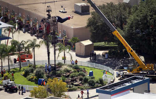 All that was left of Big Tex, besides the frame, was his arms, after the icon of the State Fair of Texas burned Friday morning, Oct. 19, 2012, in Fair Park, Friday, Oct. 19, 2012 in Dallas. Big Tex, the metal cowboy whose slow drawl of