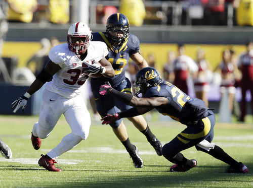 Marcio Jose Sanchez | The Associated Press Stanford running back Stepfan Taylor (33) runs past California linebacker Dan Camporeale (43) and defensive back Josh Hill (23) during the second half of an NCAA college football game in Berkeley, Calif., Saturday, Oct.  20, 2012. Stanford won 21-3. (AP Photo/Marcio Jose Sanchez)