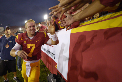 Southern California quarterback Matt Barkley is congratulated by fans after an NCAA college football game against Colorado, Saturday, Oct.20, 2012, in Los Angeles. (AP Photo/Mark J. Terrill)