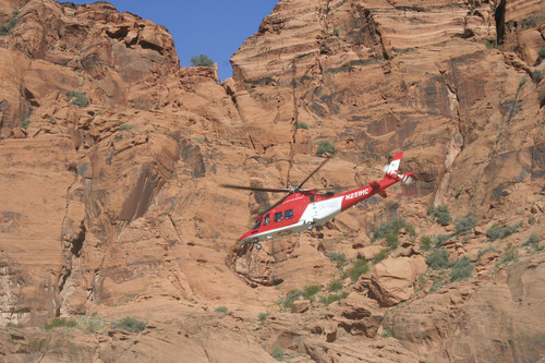 Courtesy of Washington County Sheriff's Office A helicopter flies a 15-year-old Santa Clara girl to a hospital in St. George Friday after her family found her buried in the sand at Snow Canyon State Park. The girl was playing with her younger siblings, who were burying her partially in a hole about four feet deep, which investigators believe may have caved in at some point. The girl died Saturday after being flown to Primary Children's Medical Center in Salt Lake City.
