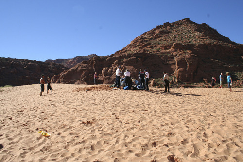 Courtesy of Washington County Sheriff's Office Rescue crews work on 15-year-old Santa Clara girl who was found buried in the sand Friday at Snow Canyon State Park. The girl, who was playing with her younger siblings in the sand, died Saturday after being flown to Primary Children's Medical Center in Salt Lake City.