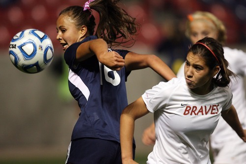 Kim Raff | The Salt Lake Tribune Bountiful player (right) Christina Plank and Bonneville player Emilie Tafuna'i compete for a ball during the 4A girls state championship game at Rio Tinto Stadium in Sandy, Utah on October 19, 2012. Bonneville went on to win the game 1-0.