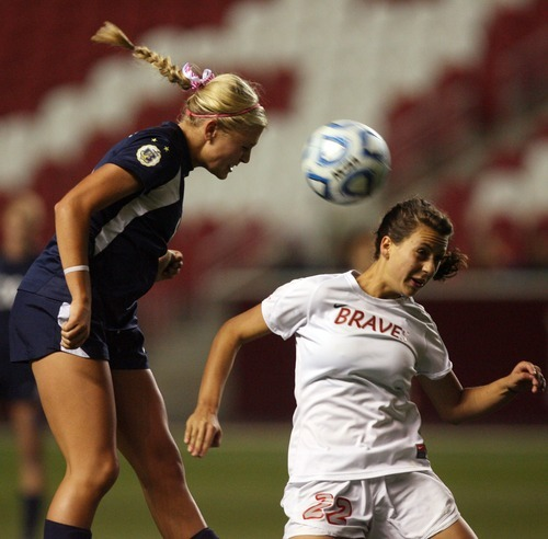 Kim Raff | The Salt Lake Tribune Bountiful player (right) Jenny Skedros and Bonneville player Lexie Stratford compete for a head ball during the 4A girls state championship game at Rio Tinto Stadium in Sandy, Utah on October 19, 2012. Bonneville went on to win the game 1-0.