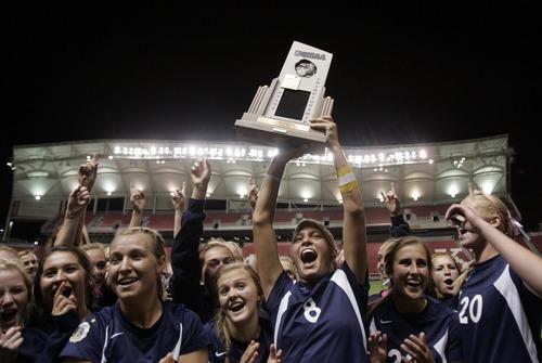 Kim Raff | The Salt Lake Tribune Bonneville players celebrate defeating Bountiful during the 4A girls state championship game at Rio Tinto Stadium in Sandy, Utah on October 19, 2012. Bonneville won the game 1-0.