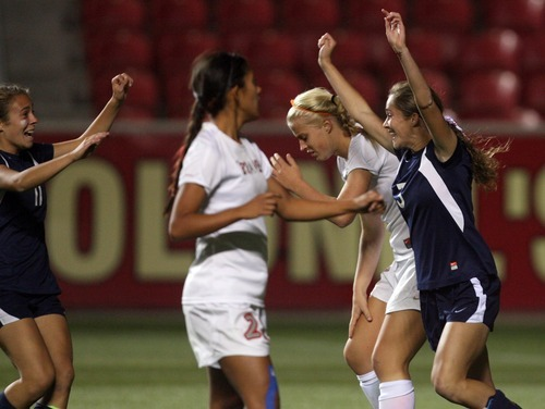Kim Raff | The Salt Lake Tribune Bonneville players (right) Karlie Eichmeier and Ellee Hall celebrate Echmeier's goal against Bountiful during the 4A girls state championship game at Rio Tinto Stadium in Sandy, Utah on October 19, 2012. Bonneville won the game 1-0.