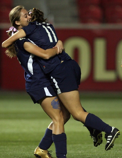 Kim Raff | The Salt Lake Tribune Bonneville players (left) Karlie Eichmeier and Ellee Hall celebrate Echmeier's goal against Bountiful during the 4A girls state championship game at Rio Tinto Stadium in Sandy, Utah on October 19, 2012. Bonneville won the game 1-0.