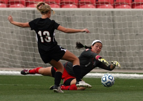 Kim Raff | The Salt Lake Tribune Alta goalie Elyssa Hashimoto makes a diving save as Viewmont player McKenna Kimber tries to take a shot during the 5A girls state championship game at Rio Tinto Stadium in Sandy, Utah on October 19, 2012. Viewmont went on to win the game 1-0.