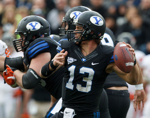Trent Nelson  |  The Salt Lake Tribune BYU quarterback Riley Nelson passes the ball as BYU hosts Oregon State college football Saturday October 13, 2012 in Provo, Utah.